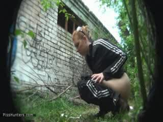 Porn Tube of Gross Chick Pees In The Jungle